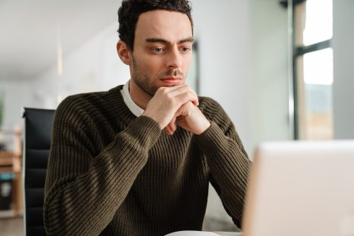 Entrepreneur working with a laptop and documents